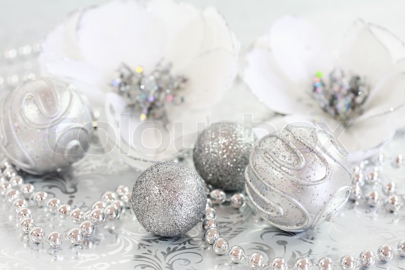 Christmas Ornaments In Silver And White Tone Stock Photo