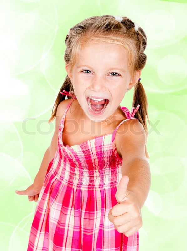 Little Girl With Thumbs Up Isolated On Stock Photo