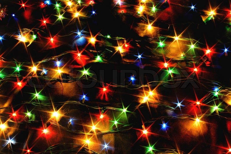xmas background with color lights on the black background stock