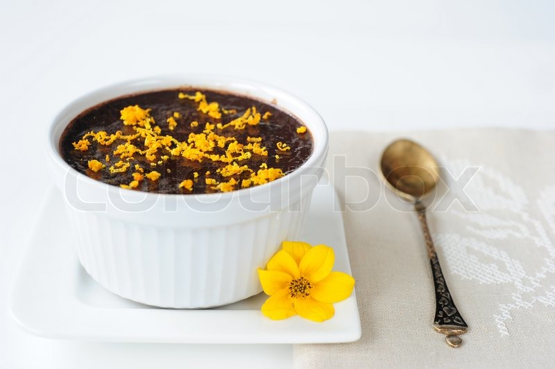 ... orange-mousse-orange-zest-lies-next-to-a-yellow-flower-and-a-metal