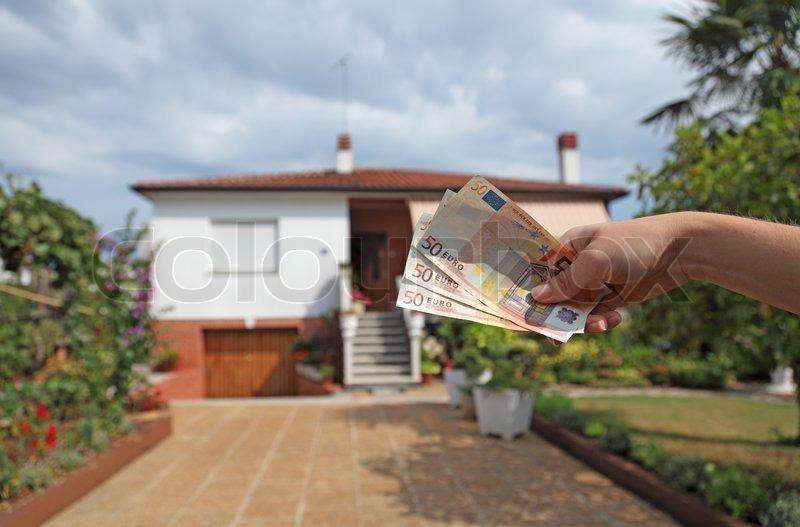 hand mit euro banknoten symbolisch f r miete oder kauf eines hauses stock foto colourbox. Black Bedroom Furniture Sets. Home Design Ideas