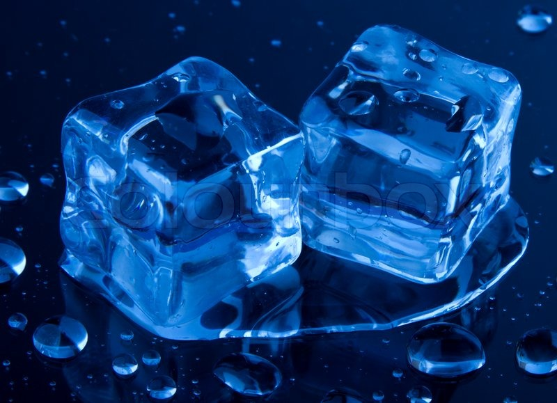 Ice Cubes Isolated On The Blue Background With Water Drops