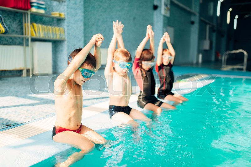 Sporty Kids Boys Doing Exercise In Swimming Pool Clean Blue Water Healthy And Happy Childhood Concept Funny Children