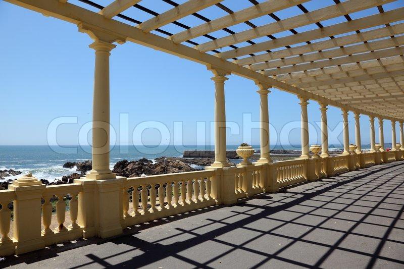 pergola at the beach in porto portugal stock photo colourbox. Black Bedroom Furniture Sets. Home Design Ideas