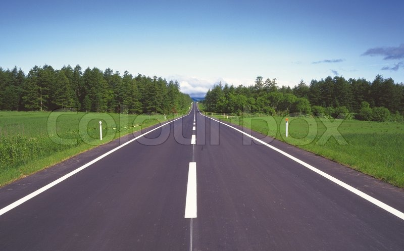 Empty curved road,blue sky and sun, stock photo