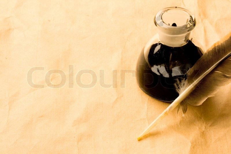 feather and ink bottle isolated on