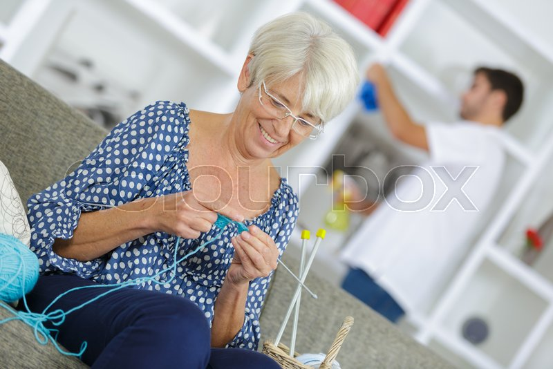 Stock image of 'Beautiful senior lady sewing'