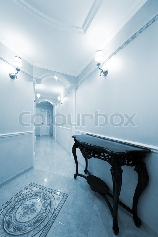 Beautiful Table In A Light Corridor With A Door | Stock Photo | Colourbox