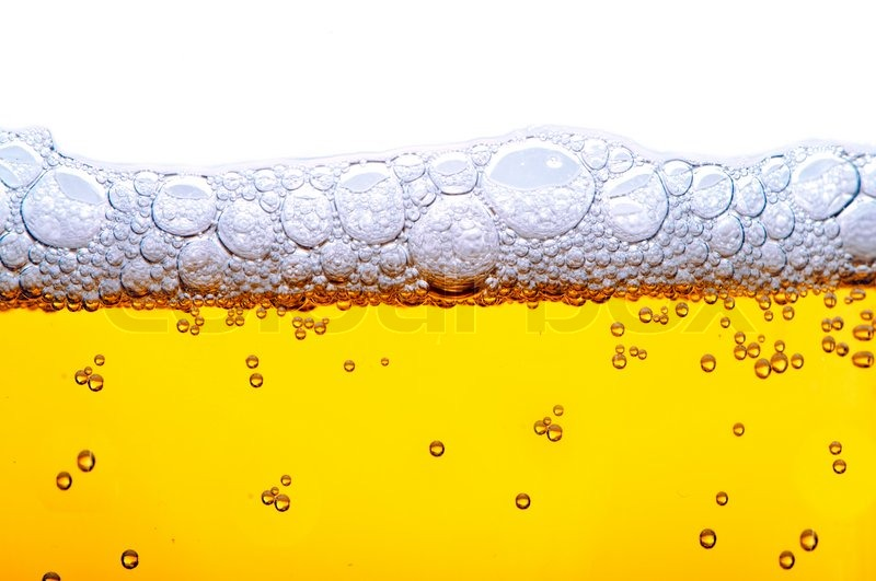 Close Up Shot Of Yellow Beer With Foam And Bubbles On