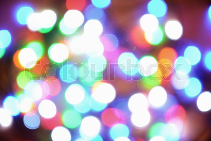 New-year electric garland on a wooden background. Bright bulbs on a wooden table and sprigs of a Christmas tree. , stock photo