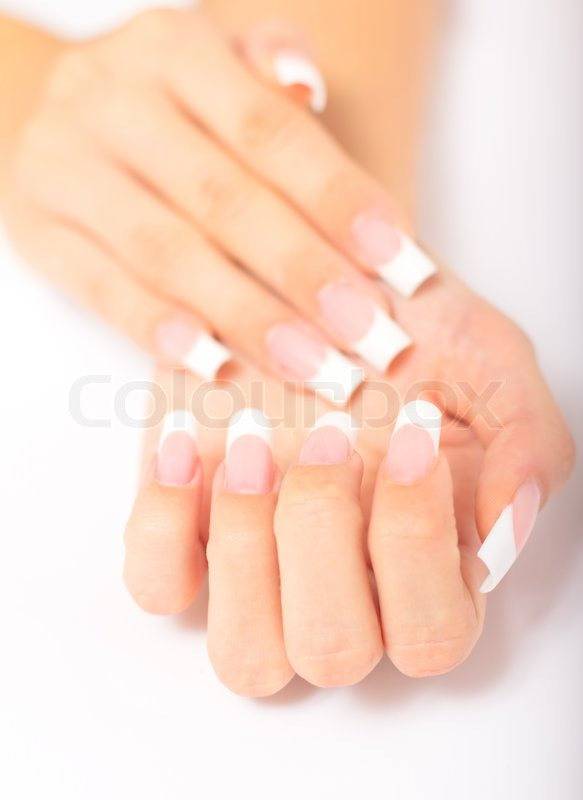 Beautiful Female Hands With French Manicure On A Light