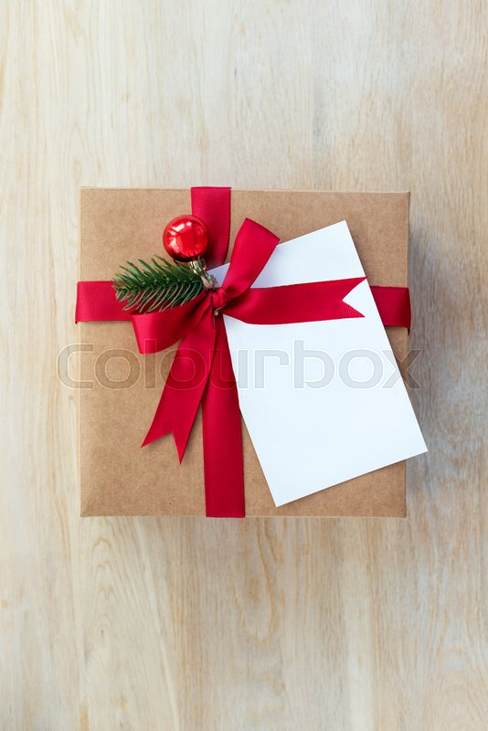 Packing Christmas gifts. Blank gift card with free space for text and holiday decorations. Top view, stock photo