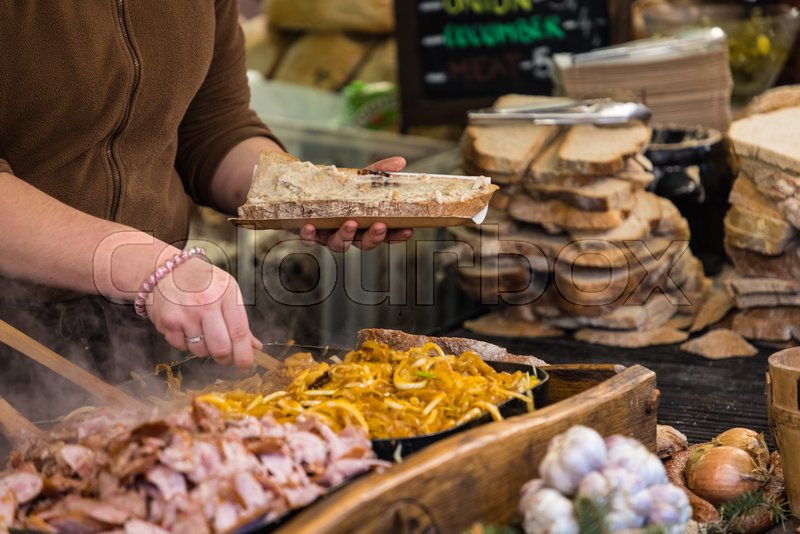 Food booth selling traditional Polish street food in Main Square, Kraków at Christmas market, stock photo