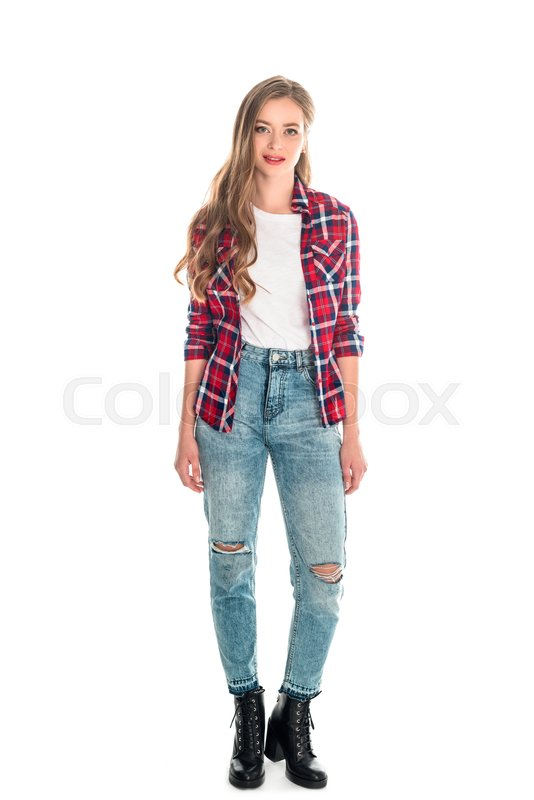 10fc151847f Full length view of beautiful young woman in checkered shirt and jeans  looking at camera isolated on white