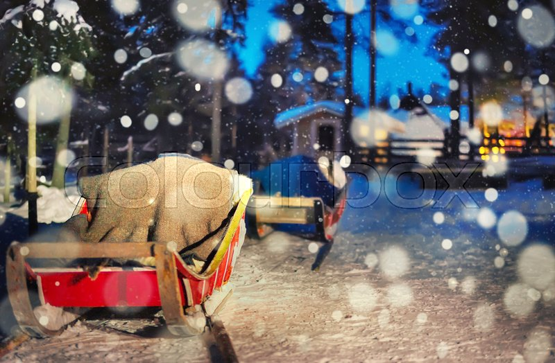 Reindeer sledding in night safari farm in Rovaniemi, Lapland, Finland. Snowfall Toned, stock photo