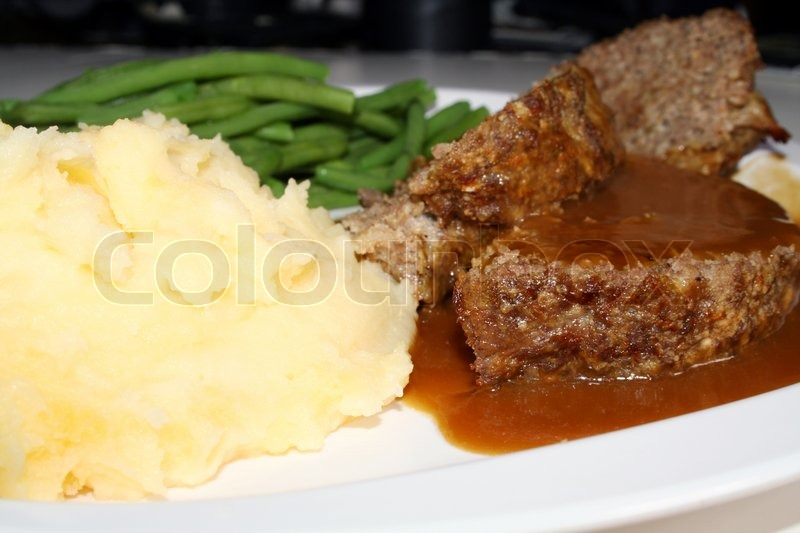 Meatloaf, mashed potatoes, green beans and gravy stock photo