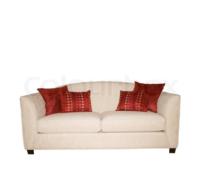 White sofa with decorative red pillows isolated on white Stock Photo Colourbox