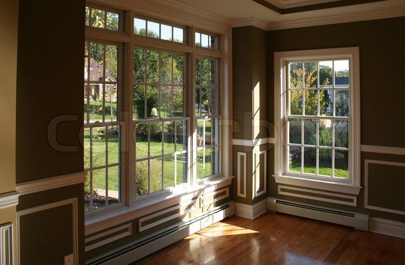 Sunny corner in living room with garden view through for Garden room windows