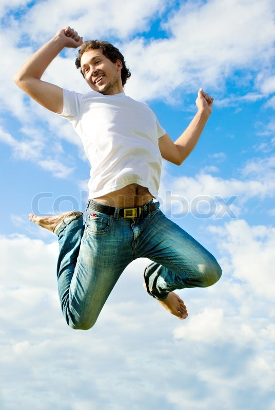 Man Jumping In A Meadow Stock Photo Colourbox