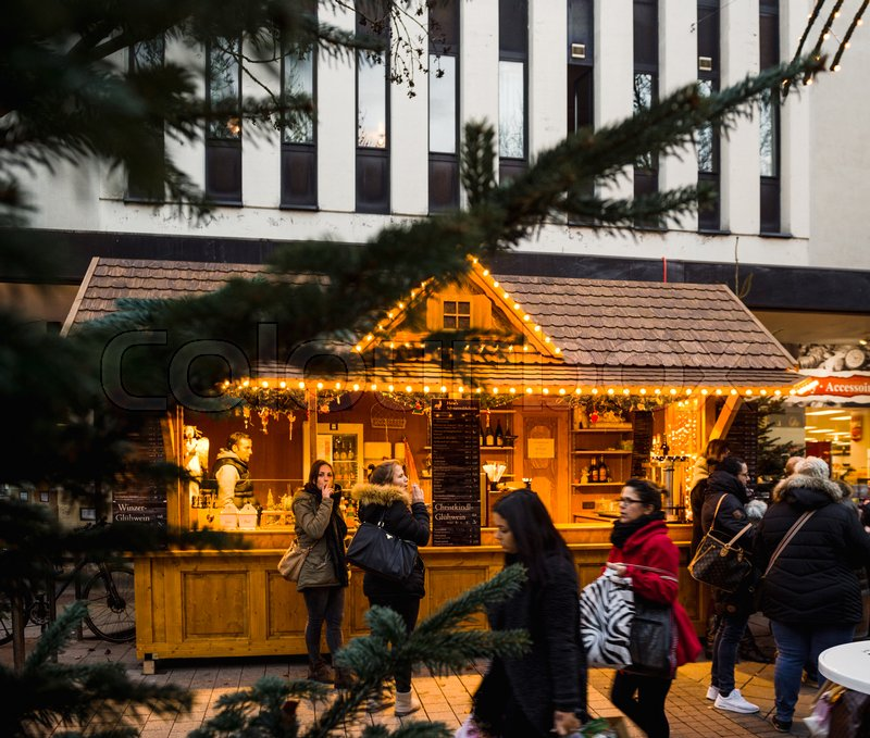 kehl germany dec 13 2016 german christmas market stall chalet at dusk in central kehl city in baden wurttemberg with tourist and local people walking