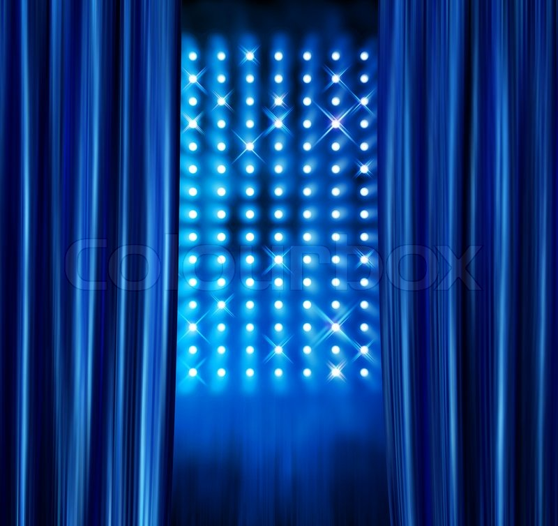 Stock image of 'Blue satin curtains reveal stage spotlight lamps wall'