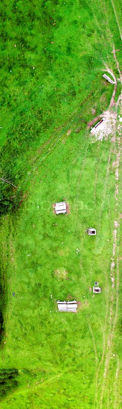 Overhead aerial panoramic view of mountain meadows in summer season, stock photo