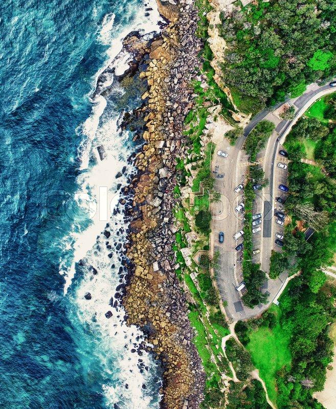 Panoramic overhead view of ocean rocks, stock photo