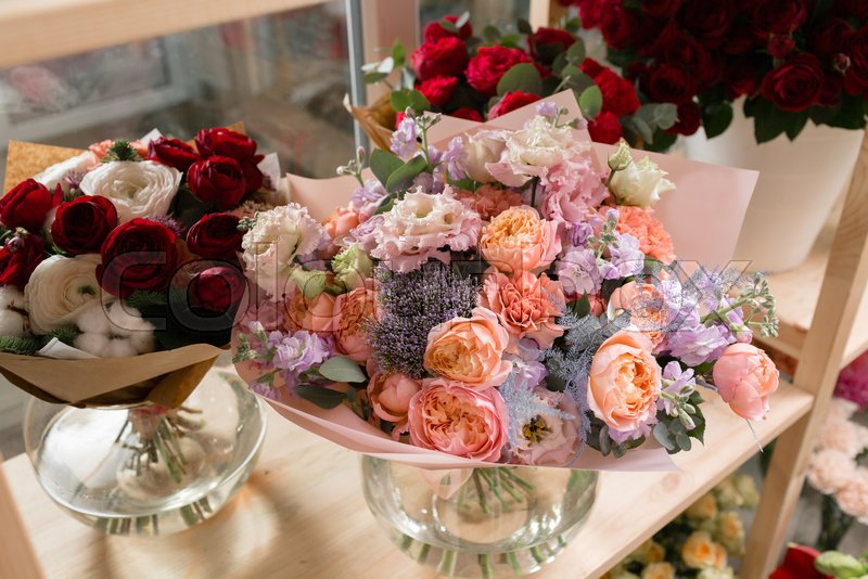 Different varieties fresh spring flowers in refrigerator for different varieties fresh spring flowers in refrigerator for flowers in flower shop bouquets on shelf florist business stock photo colourbox mightylinksfo
