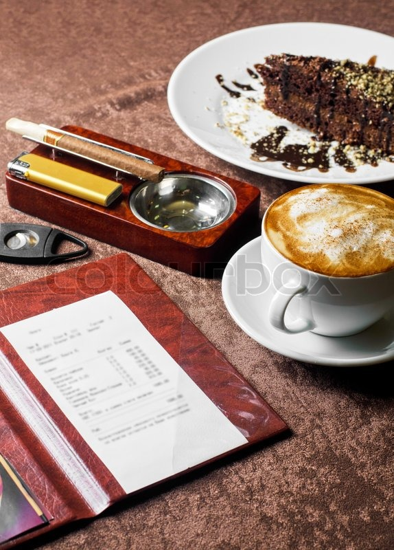 Check, ashtray, cigar, lighter and coffee at restaurant table, stock photo