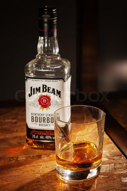 lviv ukraine december 04 bottle of jim beam whisky and glass on