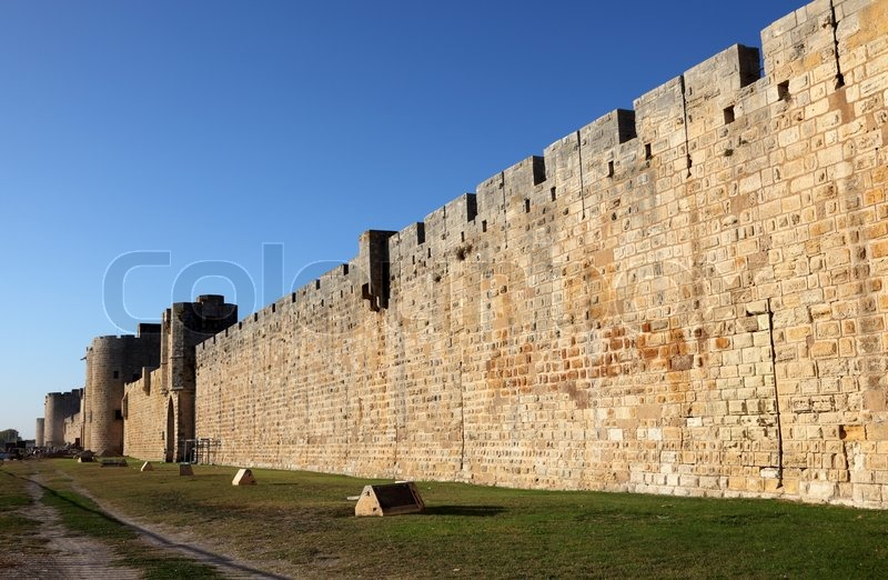 City wall of the medieval town Aigues-Mortes, France, stock photo