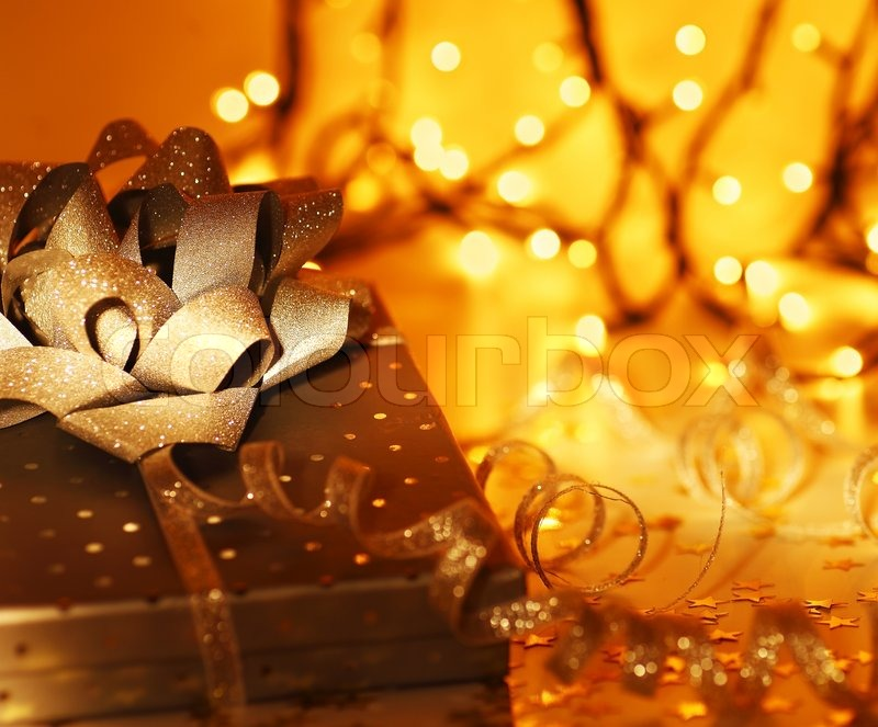 shiny christmas gift box ornament holiday decoration over abstractgolden lights background stock photo colourbox