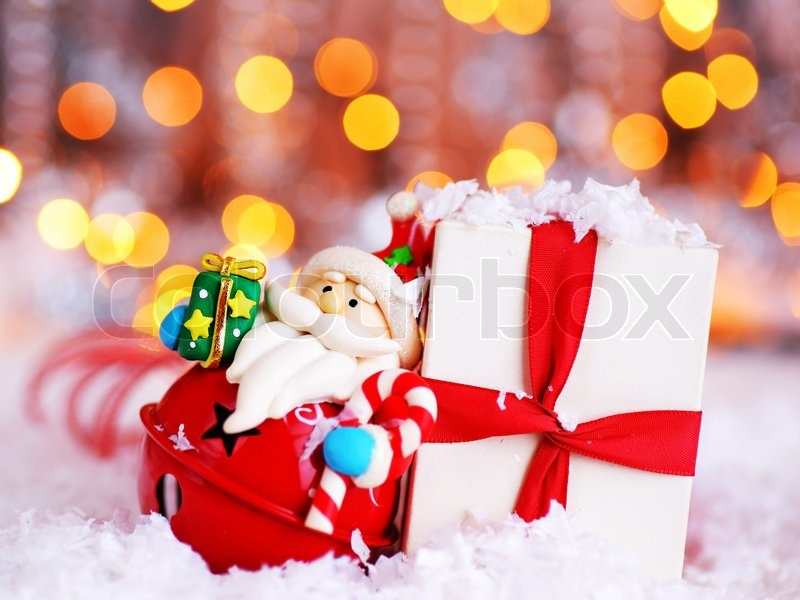 holiday background with cute santa claus christmas tree decorative ornament gift box in snow over abstract defocus lights stock photo colourbox