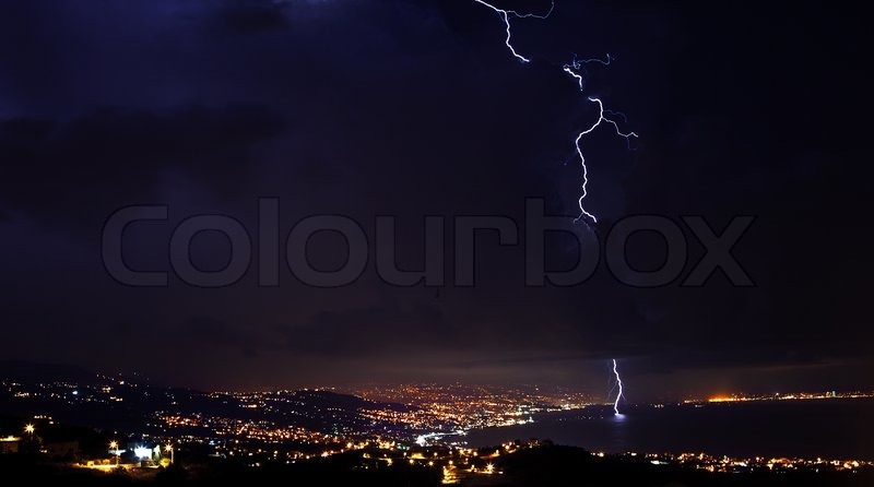 Lightning, thunderstorm at night sky, overcast winter weather with dramatic sky over city, stock photo