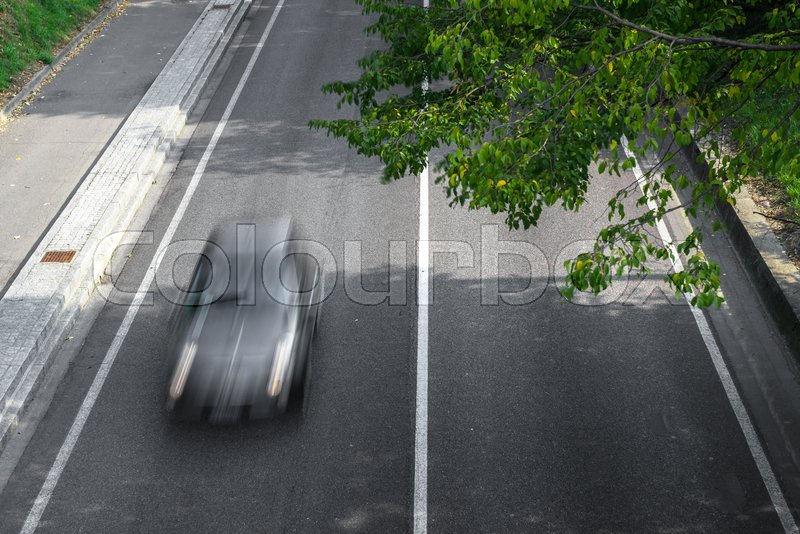 Motion blur of cars in aerial view over the road. (Speed limits - Infractions - Speed Cameras), stock photo