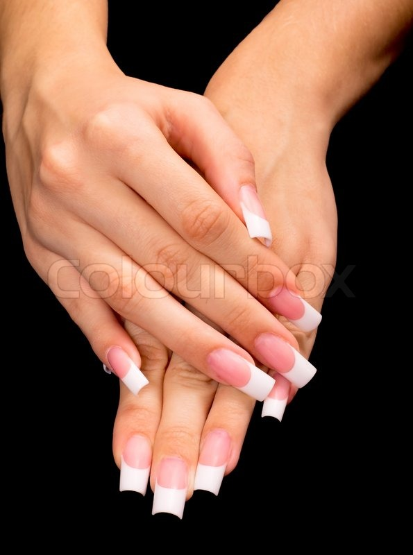 Beautiful hands with french manicure on black background ...