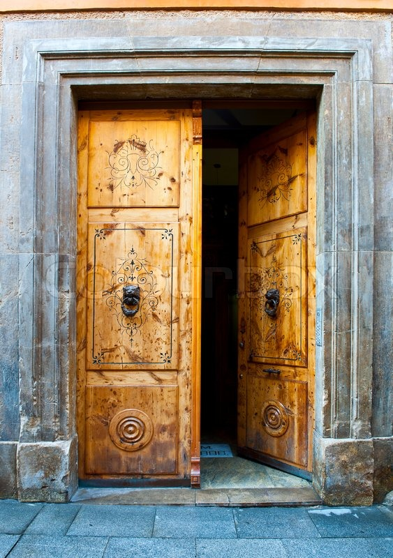 Wooden Open Door With Knockers In The Form Of A Lions