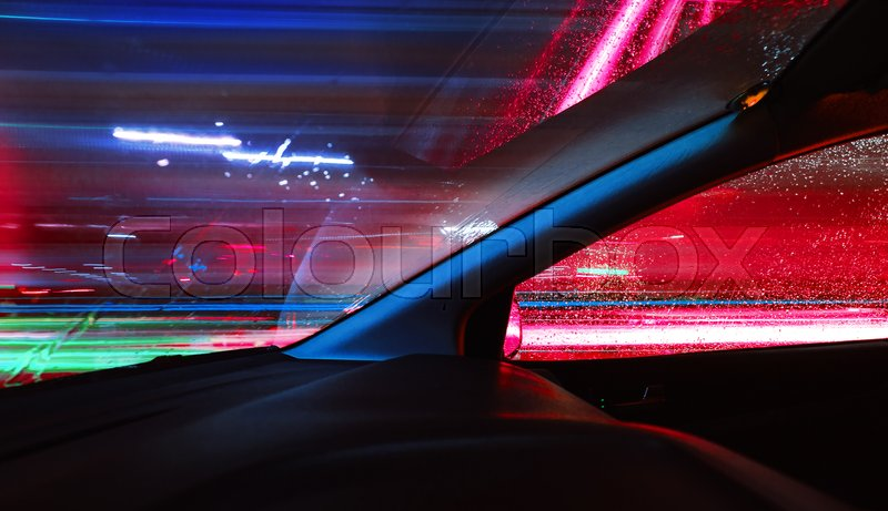 Night driving.Long exposure photo.City colorful night lights perspective blurred by high speed of the car, stock photo