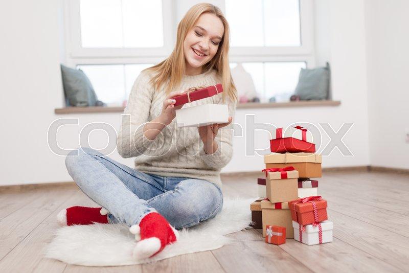 Smiling teen sucking cock