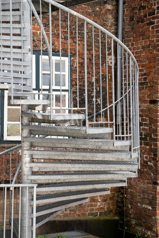 Modern Exterior Spiral Staircase Of Metal In The Backyard On An Old Brick  Building, Fire Escape In The Old Town | Stock Photo | Colourbox