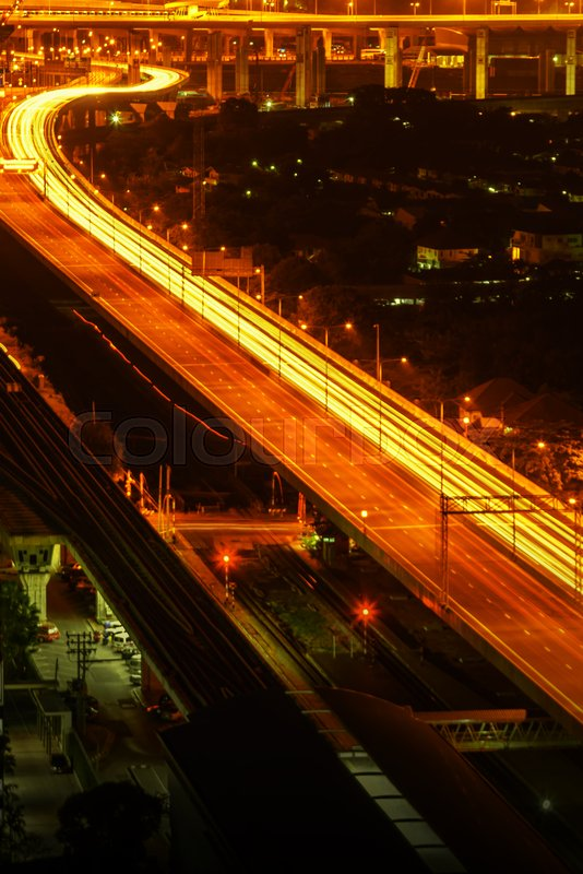Transportation in modern city, Street night light, light trails at night on motorway, urban view at night time, stock photo