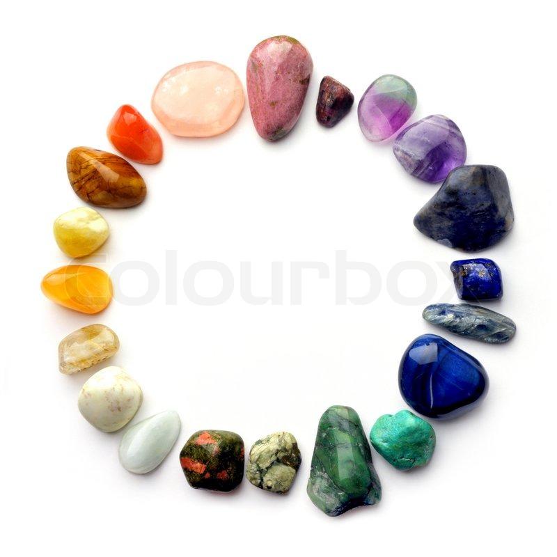 Semiprecious gemstones of various colours in round border ...
