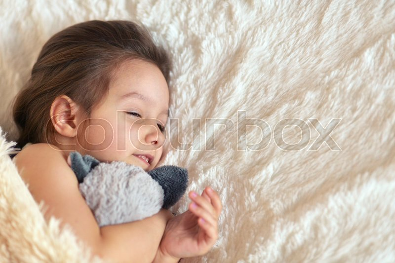 Cute Little Girl Sleeping In A Bed Stock Image Colourbox