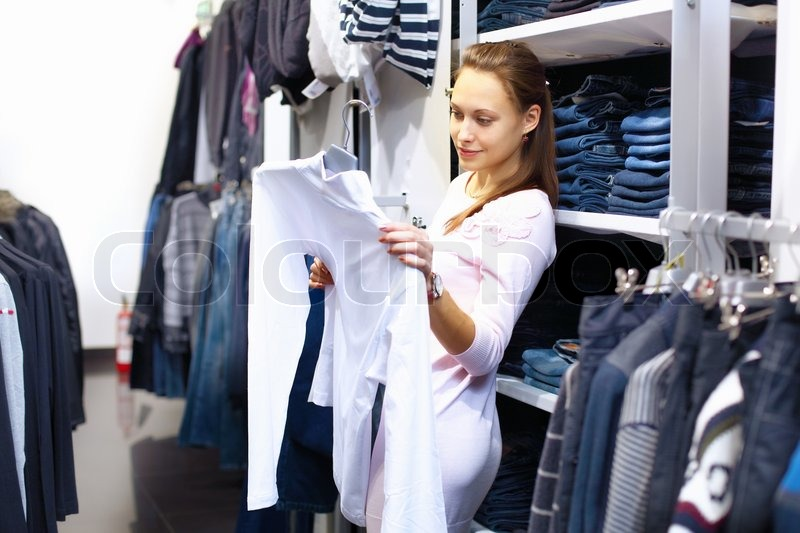 c623d8b84f3da Young woman doing shopping in clothes ... | Stock image | Colourbox