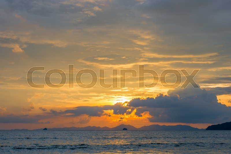 Stunning sunset sky over the sea at sunset time, stock photo