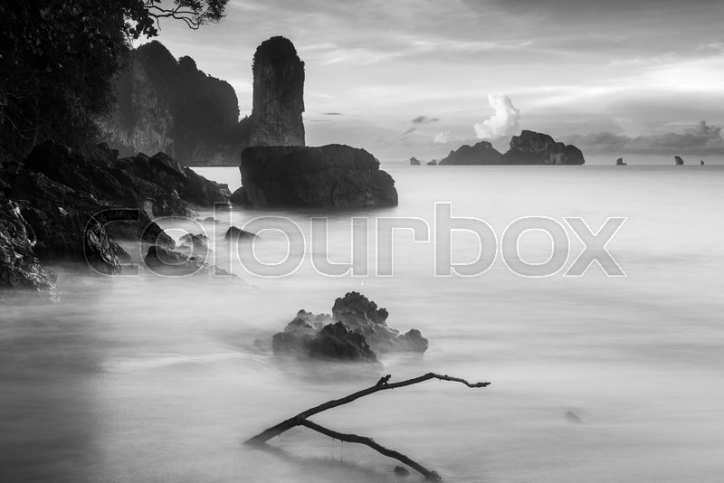 Black and white landscape with rocks in the sea at dawn Thailand, Krabi province, stock photo