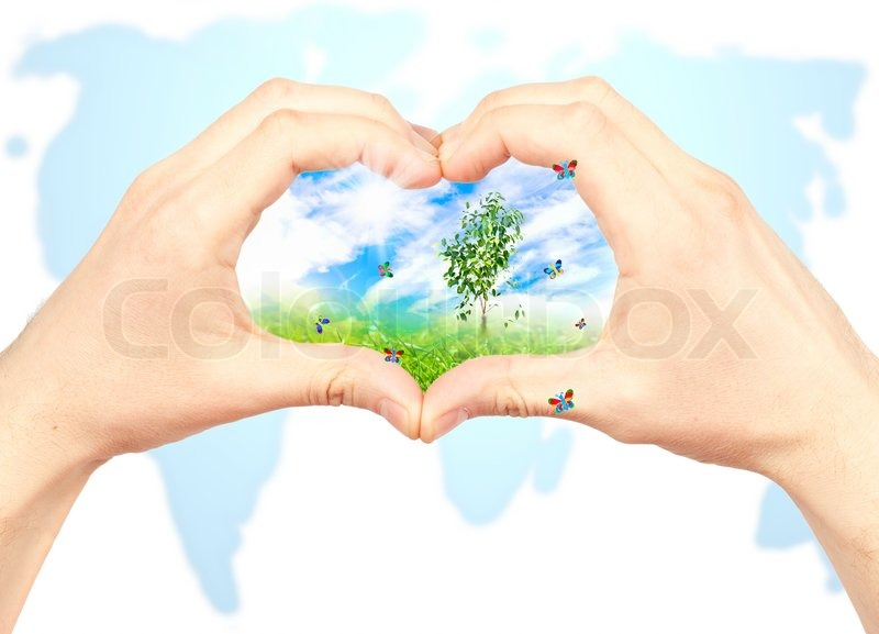 Human hand and nature on world map background symbol of the human hand and nature on world map background symbol of the environment stock photo gumiabroncs Gallery