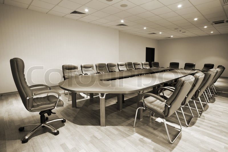 Large table and chairs in a modern conference room, stock photo