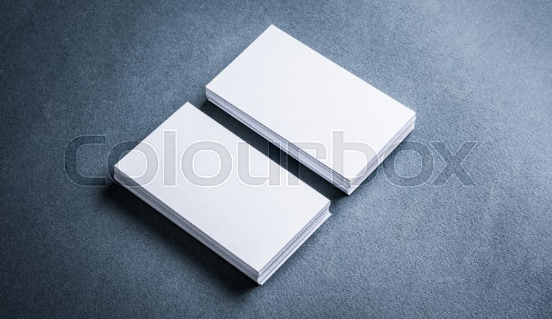 Two stacks of blank paper business cards on textured background two stacks of blank paper business cards on textured background stock photo colourbox reheart Image collections