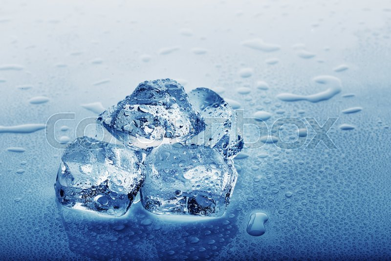 Frozen Ice Cubes In Drops On The Table Tinting Blue